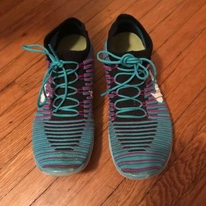 Blue and purple Nike fly knit shoes